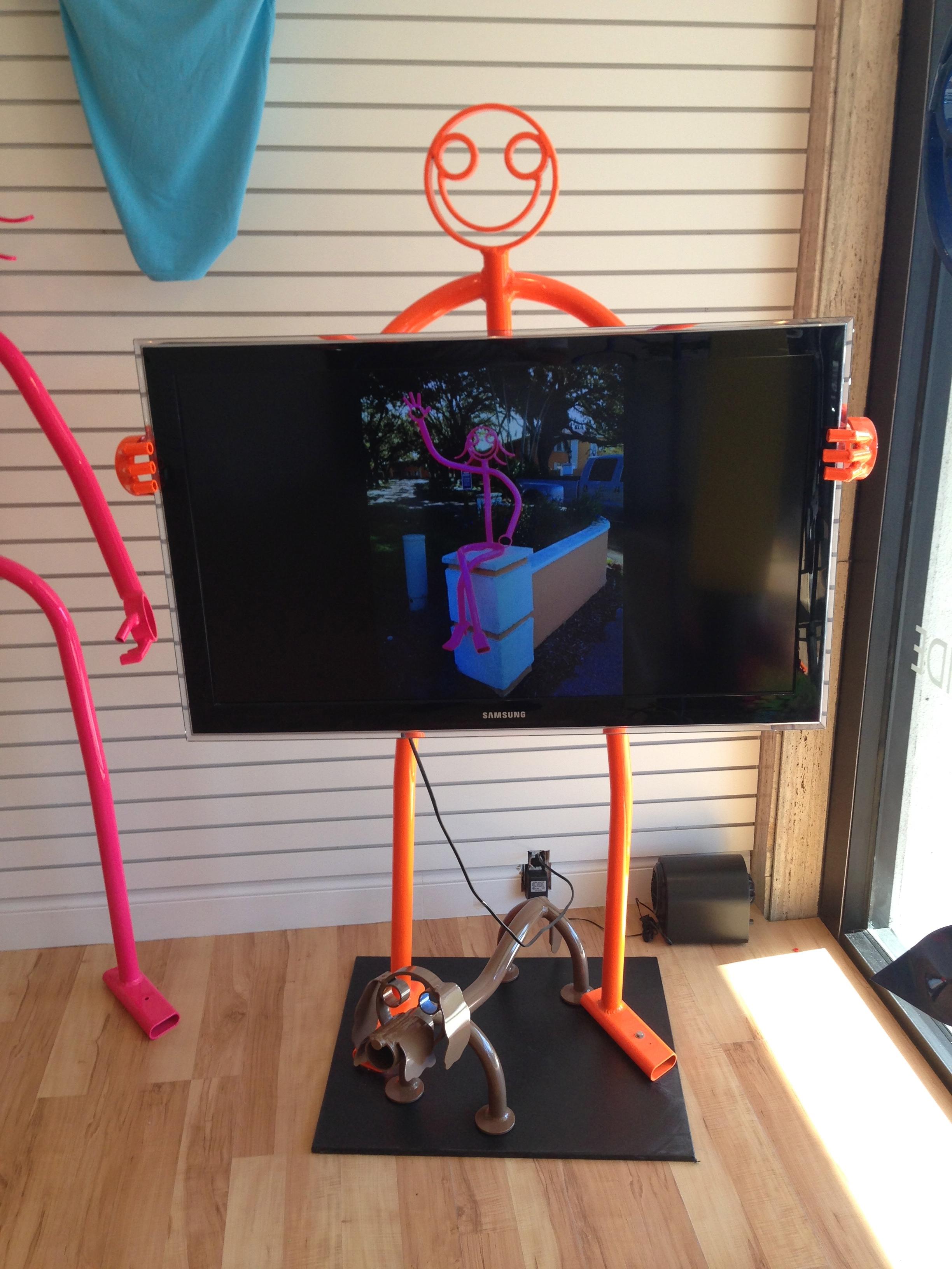 TV holding dude $1,600